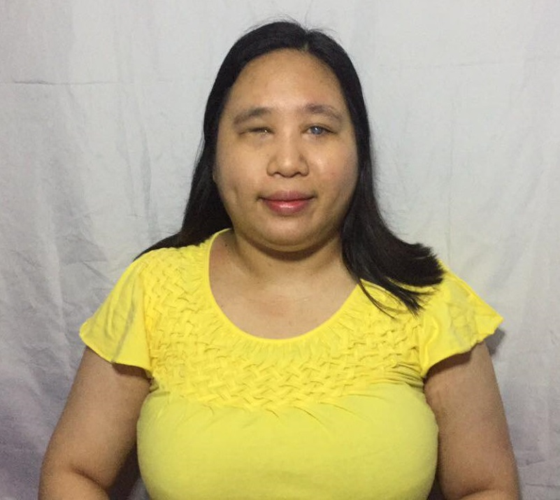 Ms. Andrea wearing a yellow blouse
