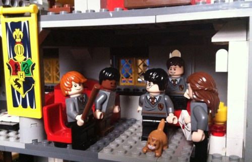 Ron, Dean, Harry, Neville and Hermione wonder if Crookshanks has eaten Scabbers in the Gryffindor common room.