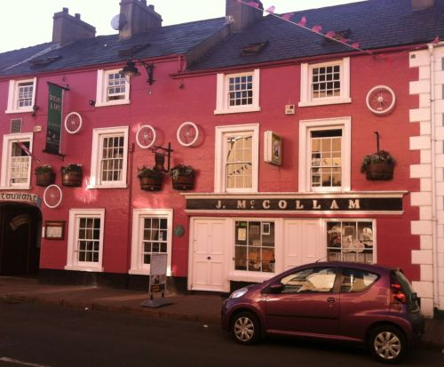 McCollam's Restaurant and Pub went completely pink for the Giro d'Italia, and hung a lot of bicycle wheels on the building for good measure.
