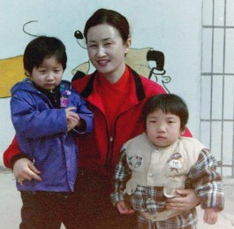 Lain's with the Orphanage Director and with her best friend, Ji Ping, at the orphanage.