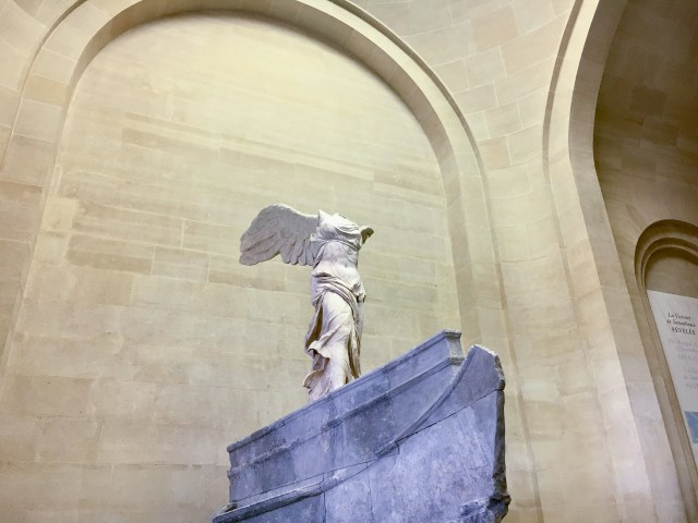 Statue made of marble with one wing, and one missing arm