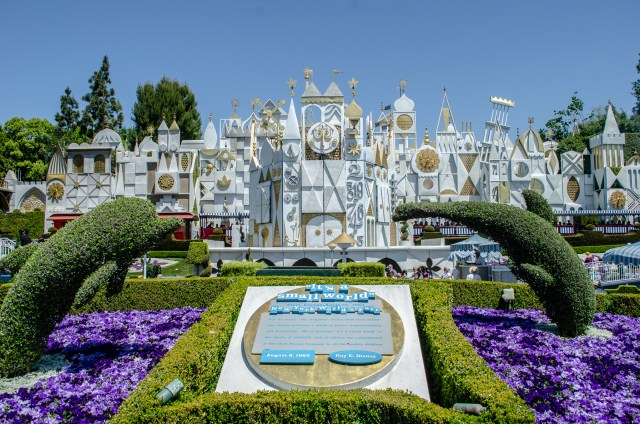 "Structure that is white and full of gadgets, with a sign out front that reads ""It's A Small World"""