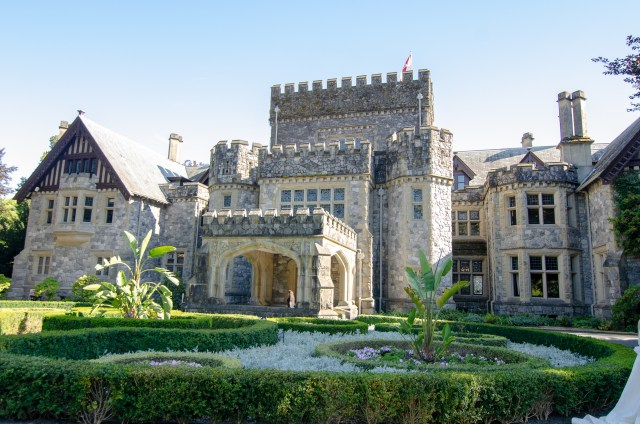 Full frontal of a Victorian castle entrance, colored grey