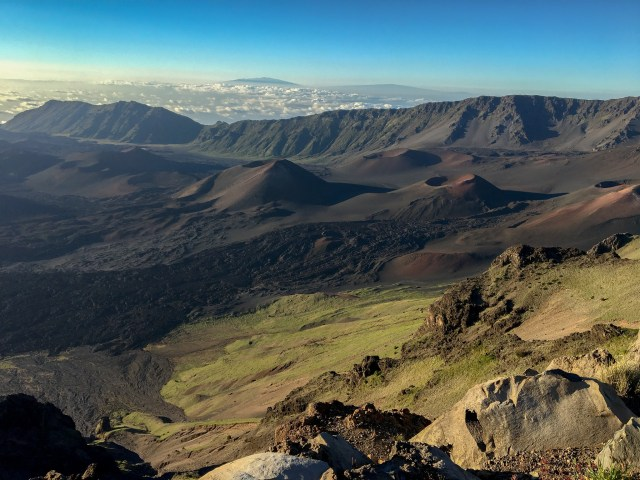 One of the top things to do in Maui for first timers is view these barren craters and mountains, with sun rising in the background