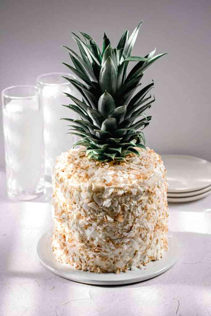 piña colada cake with coconut swiss meringue buttercream