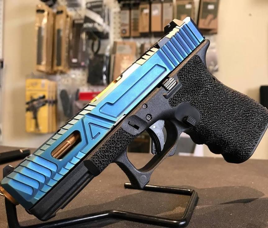 agency arms exa tactical custom glock slide blue glock slide chameleon glock slide 1
