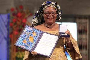 Image source: REUTERS/Cornelius Poppe/Scanpix Pictured: obel Peace Prize winner, Liberian peace activist Leymah Gbowee, poses with her award at the award ceremony in Oslo, December 10, 2011.