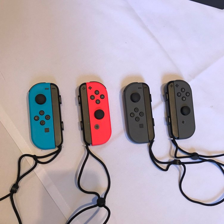 Two versions of the Nintendo Switch's Joy Con controllers