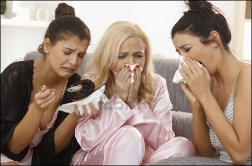 17975210-portrait-of-three-crying-women-at-home-sharing-sorrow-wearing-pyjamas