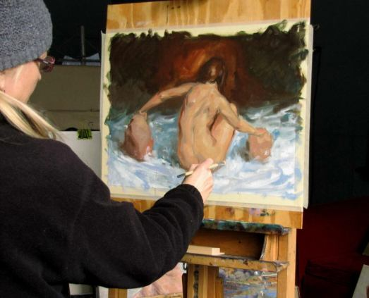 Judith Reeve painting in her studio