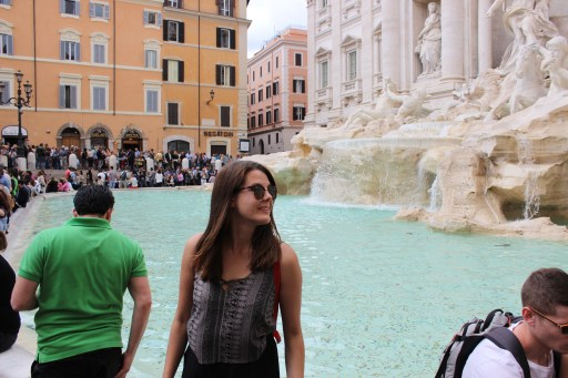 Making sure to return Rome some day by throwing coins to Fontana di Trevi