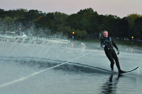 Scott Leitner slices through the cold waters of Geneva Lake during The Gummers early morning waterskiing ritual.