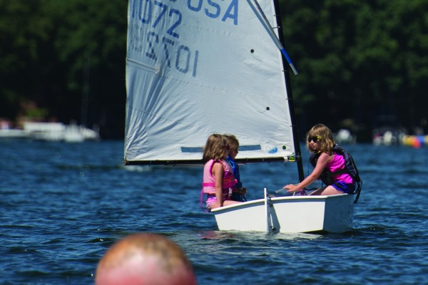 "Younger kids take the ""Learn to Sail"" program on Lake Beulah in Optimist Dinghies."