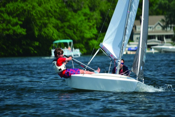 Augie Jarecki and crew Billy Webber sail an X Boat in a youth race on Lake Beulah.