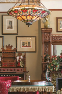 The game room is a fun place for guests to congregate. Just some of its highlights include a roulette wheel and the home's original pump organ, as well as framed architectural drawings.