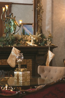 The music room with its grand piano, shimmers with gold holiday décor and candlelight. The light fixture on the mantle was originally thought to be just a figurine when Andrew spotted it at a Chicago auction.