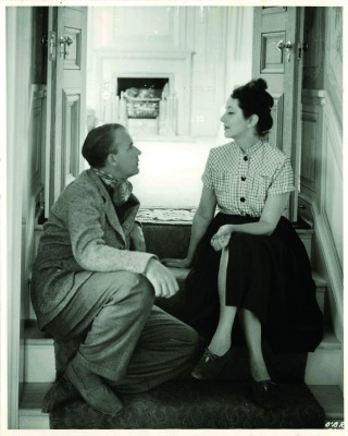 Alfred Lunt and Lynn Fontanne sit on the steps to the library in the main house at Ten Chimneys.