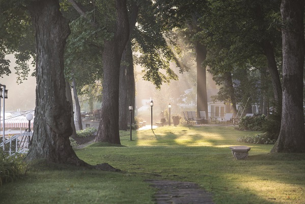 Early morning light filters through the trees along the Geneva Lake Shore Path just east of the Lake Geneva Yacht Club.