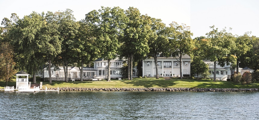 The Southern Colonial- inspired home with its signature columns and symmetrical façade has been drastically increased in size over the years and is an imposing sight on Geneva Lake's south shore.
