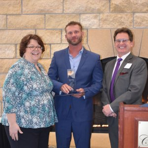 Attics to Basements Building and Renovations inc was chosen as small business of the year by the Elk River Area Chamber of Commerce in 2019
