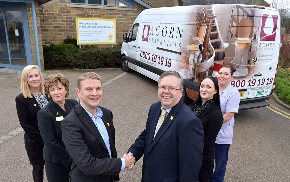 Acorn Stairlifts and Marie Curie partnership, Bradford. l-r Hayley Browning, Corporate Account Manager, Marie Curie: Christine Hamilton-Stewart MBE, Patron of Marie Curie: Peter Lee, Head of Corporate Development, Marie Curie: Dave Belmont, Company Secretary, Acorn Stairlifts:  Harriet Clay, Installation team, Acorn Stairlifts: Kathy Roebuck Healthcare Assistant. 20.01.16 Picture by Roger Moody / Guzelian