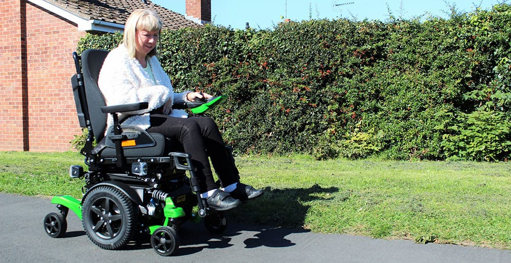 Karen Danks with Ottobock Juvo mid-wheel drive powerchair image
