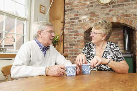 Elderly couple having a coffee image