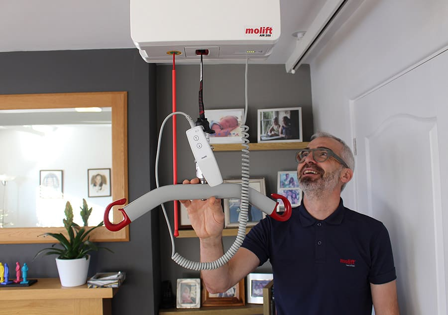 Colin Williams with a Molift hoist image