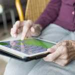 elderly woman using tablet image