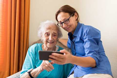 Older woman with carer image