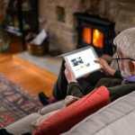 Elderly man using tablet image