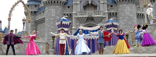 disney princes and princesses on stage with mickey and minnie mouse.