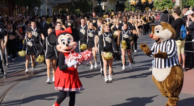 Minnie Mouse and cheerleaders in the UCF parade at Magic Kingdom
