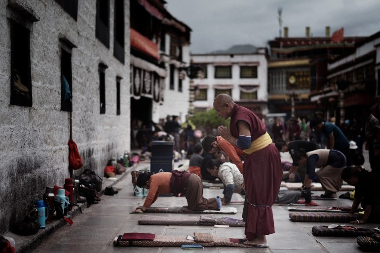 Tibetan monk praying