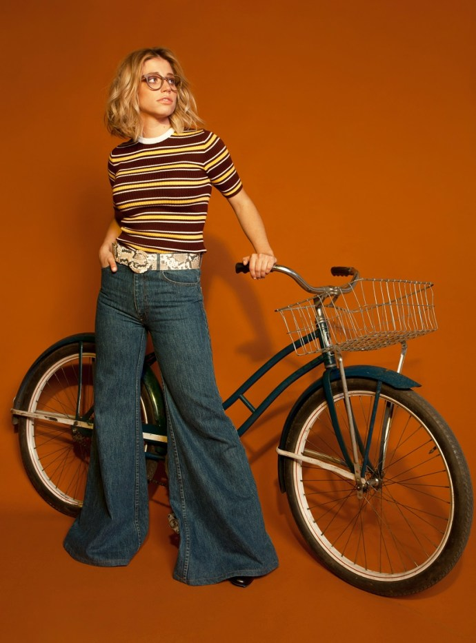 Josie Dunne poses next to a bicycle © Bree Marie Fish