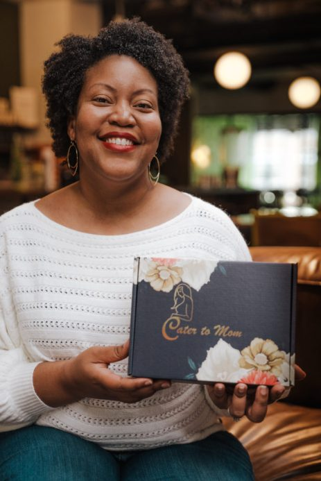Marsha Stephanson holding Cater to Mom box