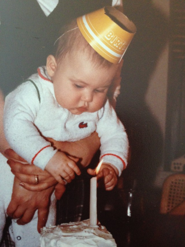 Jake's six month old half birthday. Notice the half birthday hat and cake and candle. And NO he didn't touch the flame. Bad mommy turned good mommy just in time!