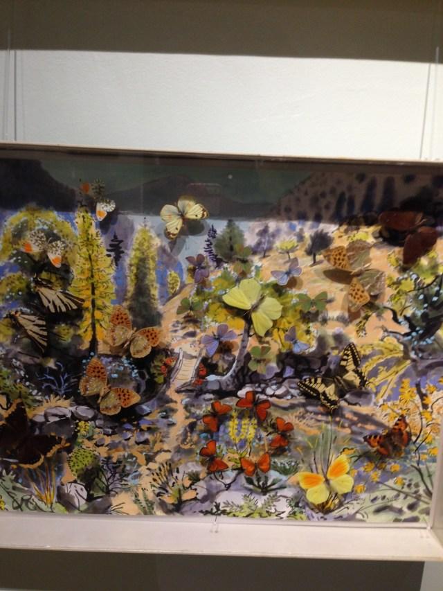 St. Tropez. La Maison des papillions. Butterflies in front of painting.