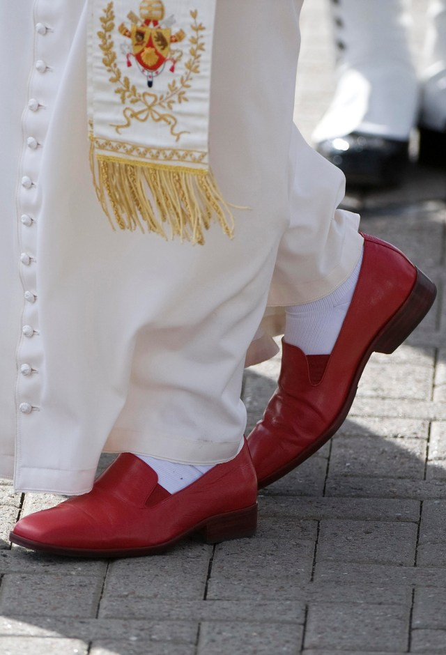 Pope Benedict XVI's red shoes are seen in 2010 as he arrives at Edinburgh Airport in Scotland. Pope Benedict will leave behind his emblematic red shoes after ending his papacy Feb. 28. A Vatican official said he will wear brown shoes, beginning with loafers he was given as a gift last March during a visit to Leon, Mexico. (CNS photo/Derek Blair, Reuters) (Feb. 26, 2013) See BENEDICT-AFTER Feb. 26, 2013.