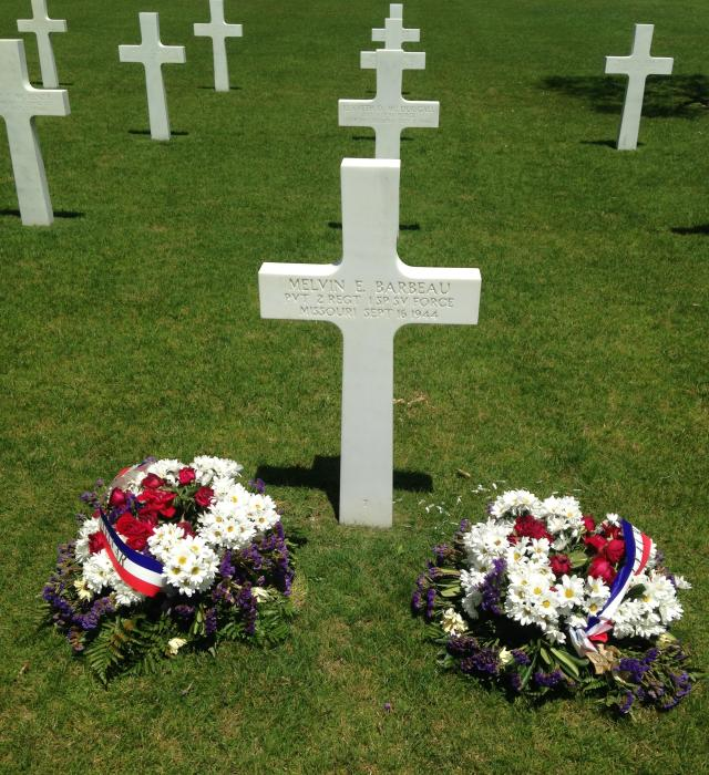 Draguignan. Tombstone of soldier with memorial flowers GOLD