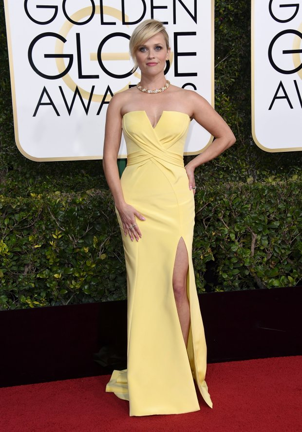 Reese Witherspoon delights in this classic gown that fits her beautifully from cut to color at the Golden Globe Awards on January 8, 2017 in Beverly Hills, California. (Photo by Jordan Strauss/Invision/AP)