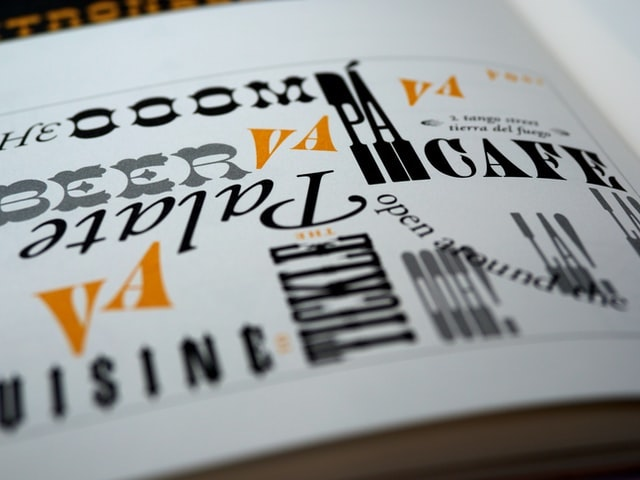 An open book showing various typefaces