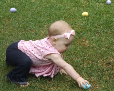 A toddler hunts for eggs at the 1st Annual Employee Spring Fling and Easter Egg Hunt hosted by President Brooks Keel and First Lady Tammie Schalue on March 26. (Photo: Shellie Smitley)