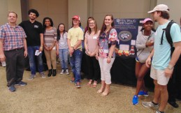 A group of students gather together for a photo at the Inquiry Expo. (Photo: Jamie Sapp)