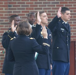 Lt. Col. Jessica Williss leads the contracting oath at the Veterans Day ceremony on Nov. 11, with cadets Jacob Gaudio (center), Jerry Farmer (left) and Daniel Shanahan (right). (Photo: Jamie Sapp)
