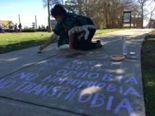 Tamika Harris, armed with a paint brush and a mixture of water and chalk, kneeled down on the sidewalk to show support for the multiple student organizations present. (Photo: Jacob Tomberlin)