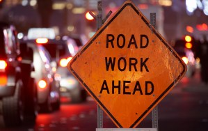 Road construction safety sign, Utility Work Ahead, while repairing a street. auburn, traffic alert, traffic delays, city of auburn