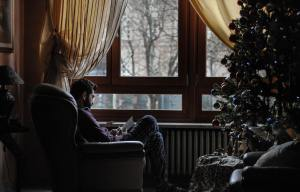 paola chaaya, self care, christmas, christmas self care, reading by the window