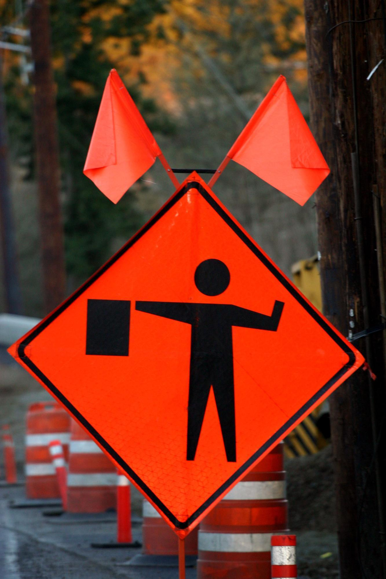 flagger, road work, construction site, traffic