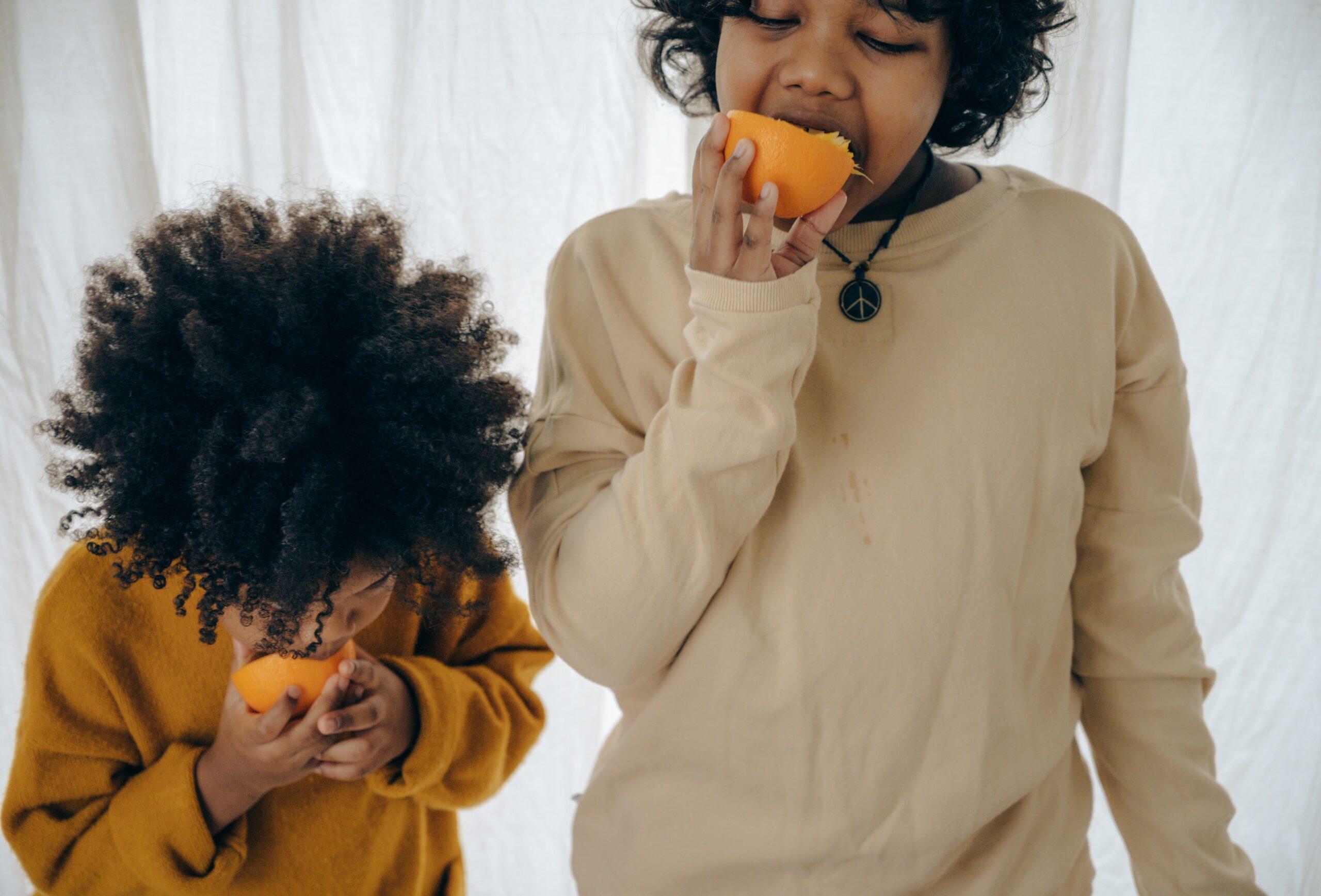 oranges, kids eating, child food, nutrition, Ketut Subiyanto